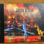 """Cover of Jason Aldean autographed """"Burn It Down"""" Tour Photo Book"""