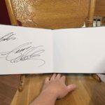 """Signed page of Jason Aldean autographed """"Burn It Down"""" Tour Photo Book"""