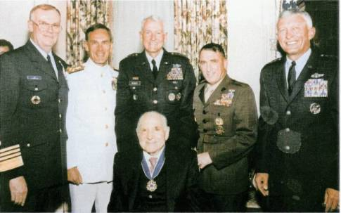 Zachary Fisher and the Joint Chiefs of Staff at a reception following the presentation of the Presidential Freedom Award. (September 14, 1998)